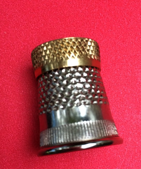 Raised Edge Thimble. Double reinforced forged brass top has a raised edge with deep recess and substantial dimples for lasting durability. Excellent for all hand needlework.