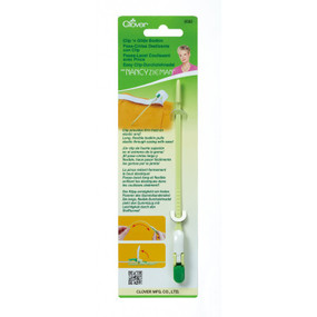 Clip provides firm hold on elastic end.  Long, flexible bodkin pulls elastic through casing with ease.