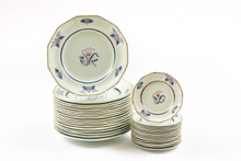 Partial Adams Calyxware Service. Dinner and Side Plates