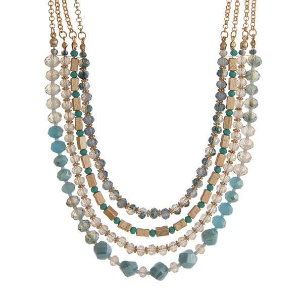 Gold tone layering necklace displaying strands of turquoise and blue glass  beads  Approximately 18