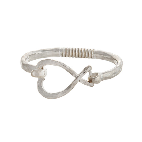 Worn silver tone latch bangle bracelet with an open heart