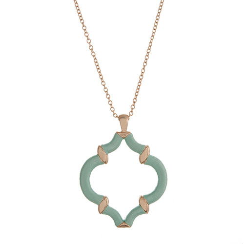 "29"" Gold tone necklace with a mint green thread wrapped quatrefoil pendant."