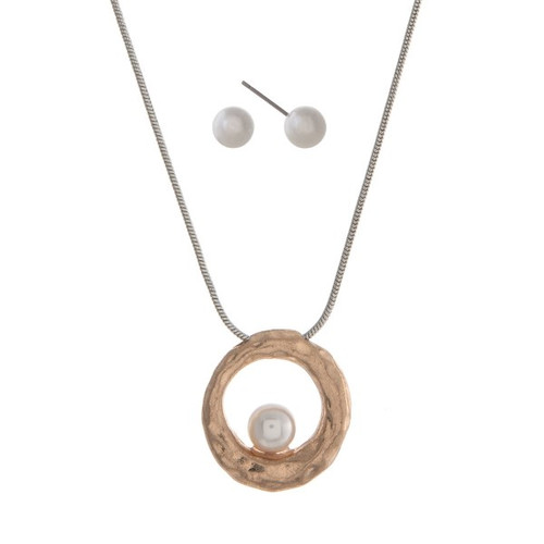 """Silver tone necklace set displaying a hammered gold tone ring with a faux ivory pearl. Approximately 18"""" in length."""