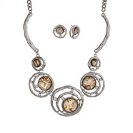 "Silver tone necklace set displaying layered rings with abalone cabochons and rhinestone accents. Approximately 17"" in length."