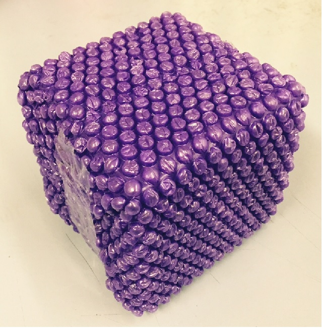 Purple Bubble Wrap wrapping a gift