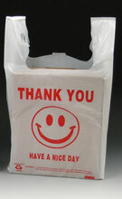"""White Plastic Merchandise T-Shirt Bags with """"Smiley Face"""" Print Message"""