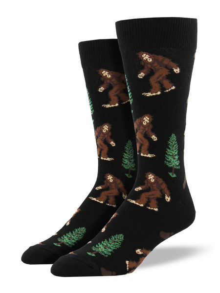 These socks are easier to find than the real bigfoot! Perfect for the Bigfoot Hunters, these socks are sure to help you feel more in-tune with our favorite sasquatch. Wear them on your next hike and maybe you'll get a rare sighting!  Sock size 10-13 fits U.S. men's shoe size 7-12.5 Fiber Content: 70% Cotton, 27% Nylon, 3% Spandex