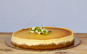 """New York Cheesecake is an American tradition made with fresh lemon, vanilla, a thin layer of graham cracker crust and then topped with decadent cream cheese. This cake goes perfect with a cup coffee!  10"""" Round, $29.95 Serves 12-14 people"""