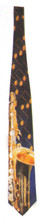 A highly detailed saxophone and music notes stand out in the foreground of this tie. Navy blue background. Made in USA. Hand-made.