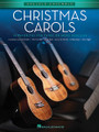 "Christmas Carols (Ukulele Ensembles Intermediate). Composed by Various. For Ukulele. Ukulele Ensemble. Softcover. 32 pages. Published by Hal Leonard.  The songs in this collection are playable by any combination of ukuleles (soprano, concert, tenor or baritone). Each arrangement features the melody, a harmony part, and a ""bass"" line. Chord symbols are also provided if you wish to add a rhythm part. For groups with more than three or four ukuleles, the parts may be doubled.  This volume includes 15 Christmas carols, including: Away in a Manger • Carol of the Bells • The First Noel • God Rest Ye Merry, Gentlemen • It Came upon the Midnight Clear • Jingle Bells • Joy to the World • O Holy Night • O Little Town of Bethlehem • Silent Night • and more."