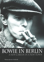 "Bowie in Berlin (A New Career in a New Town). Book. Softcover. 272 pages. Published by Jawbone Press.  Bowie in Berlin tells the fascinating story of the three years David Bowie spent in Germany in the mid-1970s, making the most extraordinary music of his career. Driven to the brink of madness by cocaine, overwork, marital strife, and a paranoid obsession with the occult, Bowie fled Los Angeles in 1975 and ended up in Berlin, the divided city on the frontline between communist East and capitalist West. There he sought anonymity, taking an apartment in a run-down district with his sometime collaborator Iggy Pop, another refugee from drugs and debauchery, while they explored the city and its notorious nightlife.  In this intensely creative period, Bowie put together three classic albums – Low, ""Heroes"", and Lodger – with collaborators who included Brian Eno, Robert Fripp, and Tony Visconti. He also found time to produce two albums for Iggy Pop – The Idiot and Lust for Life – and to take a leading role in a movie, the ill-starred Just a Gigolo. Bowie in Berlin tells the story of that period and those records, exploring Bowie's fascination with the city, unearthing his sources of inspiration, detailing his working methods, and teasing out the elusive meanings of the songs. Painstakingly researched and vividly written, the book casts a new light on the most creative and influential era in David Bowie's career."