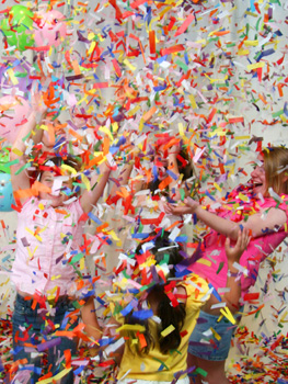 girls-playing-with-confetti-and-streamers.jpg