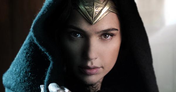 Gal Gadot as Wonder Woman with a cloak