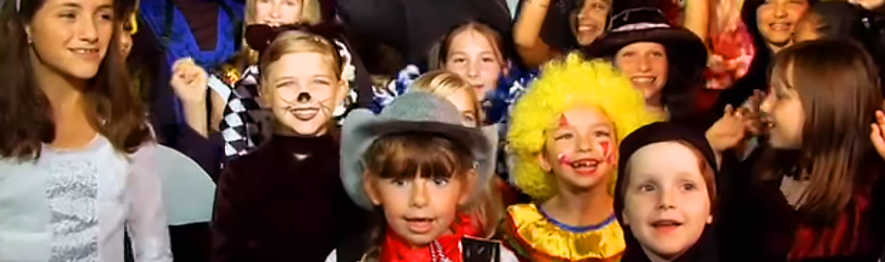 kids dressed up in costumes for Halloween