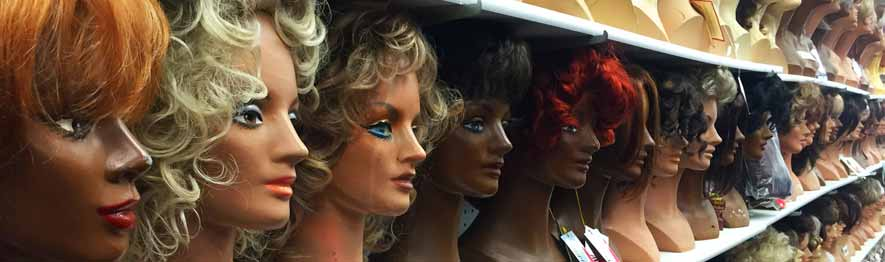 Womens wig selection showing the inside of the Chicago store with hundreds of womens wigs