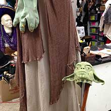 Yoda costume featuring latex hands and cotton shawl.