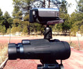 Dual mount shown here with a small video camera and binoculars attached to tripod