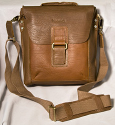 """This beautiful leather bag is perfect for work, travel or everyday use.  The adjustable shoulder strap has a leather shoulder pad.  Strap can also be removed and bag can be carried by the padded handle.  Main compartment is covered by a flap that also hides a front slide pocket.  Flap has a magnetic closure.  Full-zip main compartment, fully lined, 1 interior zippered pocket, cell phone pouch with pen loops and a key ring.  Credit card/ID card slots and two additional large slide pockets inside.  Large slide pocket, fully lined, on the back with a zipper closure.  All zippers have leather zip pulls.  Overall Measurements: 11"""" L x 4"""" W x 11"""" H"""