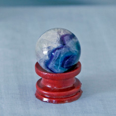 Fluorite is known to stabilize mental and emotional systems, increase the ability to concentrate and balance disorder.   Fluorite Sphere - Weight is .11 lbs or 1.76 oz., sphere is approx. 30 mm.  The Fluorite Sphere pictured is the one that you will be receiving upon purchase of this item.  Stand is not included.