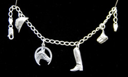 This Sterling Silver charm bracelet is perfect for any horse lover! Featuring riding helmet, horseshoe with horse head, cowboy boot, and saddle bag charms. Makes a great gift for any occasion!