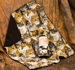 "This Cozy is covered with cute kitties.  A great favorite with cats and dogs, these double thick fleece throws are the perfect size for your pet.  Machine wash gentle cycle with a mild detergent, and hang to dry.  They are a wonderful way to protect your furniture or car seat.  Perfect for use in cat and dog carriers too.  Edges are sewn with a blanket stitch.     Measures 29"" x 36"" inches"
