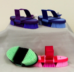 Two Tone Flexi Body Brushes in 4 fun color combinations.   Ergonomic Styling for ultimate comfort.  The design of this brush makes grooming even more enjoyable.  The back of the brush flexes to conform to the shape of your hand.  Measures 7.5 inches long and 3.5 inches wide.  Nylon webbing strap is adjustable.