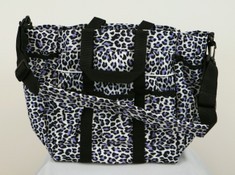 Purple Snow Leopard These fun and stylish totes can be used at the barn but also makes a wonderful tote for just about anything.  Made of 600 denier with PVC backing this durable tote features 6 smaller outside pockest, pocket on both ends with a velcro closure, plus 2 large pockets on the inside.  Tote comes with both carry handles and a padded shoulder strap.