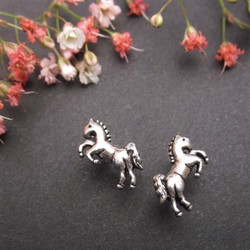 The perfect little horses for the perfect little ears. These sterling silver rearing horse earrings will put a smile on your little horse lover's face and a sparkle on her ears.  • Made of Sterling Silver • .882 Grams • Each horse stud earring has a sterling silver back • From the Wyo-Horse horse jewelry collection • Created by jewelry designer Kerstin Stock
