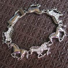 You'll enjoy the sparkle and exciting motion embodied in this running horse bracelet!  Six silver-tone horses will encircle your wrist when you put on this equestrian accessory.  Perfect for any horse-loving person.  Measures approx. 7.5 inches in length.      Made of Rhodium-plated metal alloy     Bracelet features an 'easy to use' magnetic clasp     Each piece is lead-free / nickle-free / hypo-allergenic     From the Wyo-Horse horse jewelry collection     Created by jewelry designer Kerstin Stock