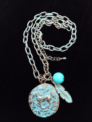 """Patina finished Hammered Running Horse Necklace with Turquoise Bead and Feather This horse medallion measures 1 1/4"""" tall. The link chain measures 18"""" long with a 2"""" extender All lead free, nickel free, hypo-allergenic.  Designed exclusively by Kerstin Stock for Wyo-Horse Jewelry"""