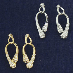 "Rhinestone Encrusted Horseshoe Nail Earrings  Available in a Gold or Silver tone. Hanging horseshoe nail earrings measures 1 5/8"" tall. Surgical steel posts All lead free, nickel free, hypo-allergenic."