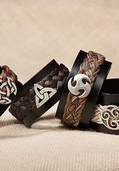 """For those who like a more urban look Cowboy Collectibles offers their Celtic concho bracelets with a wider band. The 1-1/4"""" wide black leather band features a snap closure. Basket-weave style horse hair is attached with metal end caps and our urban looking Celtic concho finish the piece.  Gift boxed. Cowboy Collectible products are still handmade in Montana.  Available in two sizes. Medium - 8"""" Large - 9""""."""