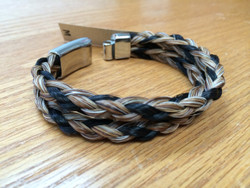 "Cowboy Collectible products are still handmade in Montana.   For a different twist, try our double braid bracelets. Featuring a stainless steel magnetic clasp for easy attachment, these bracelets are made of two braids of twisted horse hair.   Gift boxed.  Available in Medium - 8""  or Large - 9"""