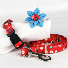"Swirls & Dots Chasin' Tail Leash  Chasin' Tail Doggie Designs are special handmade creations.  Each piece is made by hand, with care, in Boring Oregon.  Chasin' Tail handcrafted leashes are 5 feet in lenght available in 3 widths.  They feature a durable swivel hook.  Leashes are made from a washable fabric.  Gently wash and hang to dry.  Chasin' Tail dog leashes can be ironed with a cool iron to remove wrinkles if they should appear.  Chasin' Tail leashes come in the following widths.   SM 5/8"" wide  Med 3/4"" wide  LG  1"" wide  Chasin' Tail also offers matching handmade collars and cute collar accessories like Bow Ties and Flowers.  Look for them to order and complete your pet's special look."