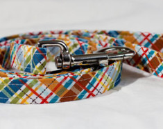 "Multi Plaid Chasin' Tail Leash  Chasin' Tail Doggie Designs are special handmade creations.  Each piece is made by hand, with care, in Boring Oregon.  Chasin' Tail handcrafted leashes are 5 feet in lenght available in 3 widths.  They feature a durable swivel hook.  Leashes are made from a washable fabric.  Gently wash and hang to dry.  Chasin' Tail dog leashes can be ironed with a cool iron to remove wrinkles if they should appear.  Chasin' Tail leashes come in the following widths.   SM 5/8"" wide  Med 3/4"" wide  LG  1"" wide  Chasin' Tail also offers matching handmade collars and cute collar accessories like Bow Ties and Flowers.  Look for them to order and complete your pet's special look."