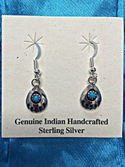 Genuine Indian Handcrafted dangle earrings with Blue Turquoise stones surrounded by black etched Sterling Silver Bear Claws, a unique and detailed piece any earring lover will admire.  Measures approx. 1 in. in length