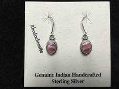 Drop Sterling Silver earrings with a beautiful Rhodochrosite Stone are sure to bring a smile.     Rhodochrosite is a pink to red manganese carbonate mineral.  It makes a beautiful gemstone that is said to have healing properties such as calming and emotional balance. It is considered a symbol of stability and love and is especially healing for the zodiac signs Virgo and Scorpio.     Stone measures approx. 1/4 in long.