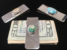 Simple yet functional with a bit of flare these metal money clips are accented with Turquoise Stones.  Easy way to keep your cash or business cards together.   Measure 2 inches long and 3/4 inches wide.     Money not incuded.