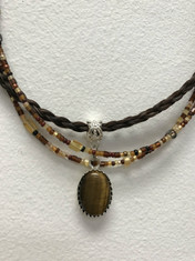 "Another winner from Cowboy Collectibles!  Cabochon Necklace with authentic Horse Hair and beads and matching earrings. cab·o·chon ˈkabəˌSHän noun: cabochon; plural noun: cabochons meaning - a gem polished but not faceted. These stunning horse hair necklaces are 18"" long, have a lobster claw closure, feature a stone cabochon with coordinating beads.  Matching earrings feature hypo-allergenic posts.                                                                    Add a coordinating beaded wrap bracelet to complete the look. Handmade in Montana USA"