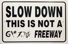 "Slow Down This is Not a Freeway Sign / 12""x18"" / Wht & Blk"