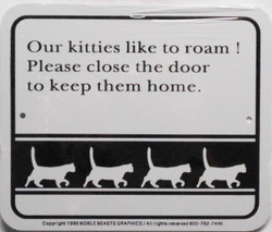 """Our kitties like to roam! Please close the door to keep them home. / 5""""H x 6""""W / White & Black"""