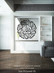 "A black ""Masha'Allah"" decal placed on a mirror."