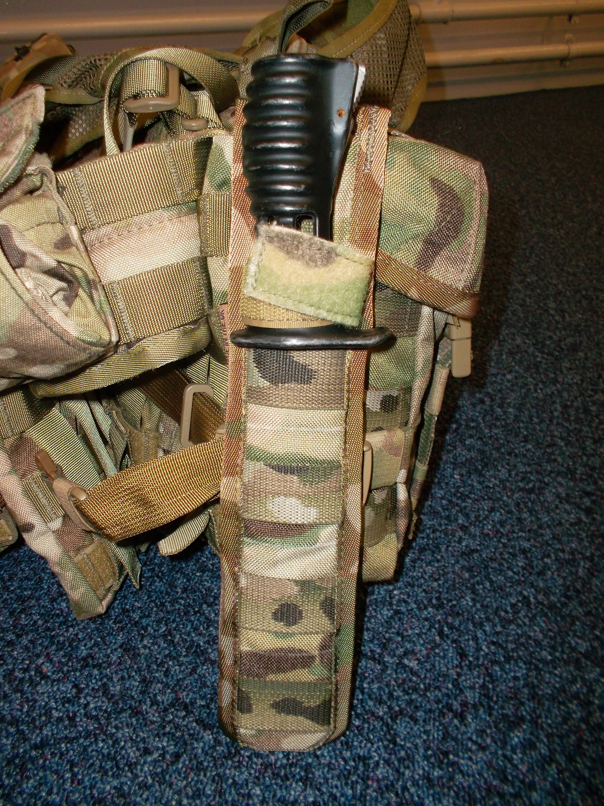 Sheath on side of pouch