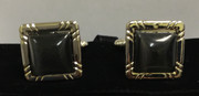 Determined Silver Square Cufflinks with a Black Stone