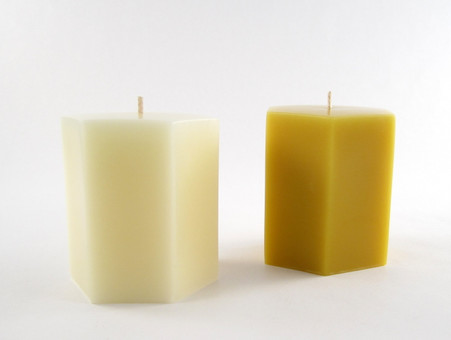 Beeswax Solid Hexagon Pillar Candle in Ivory and Natural.