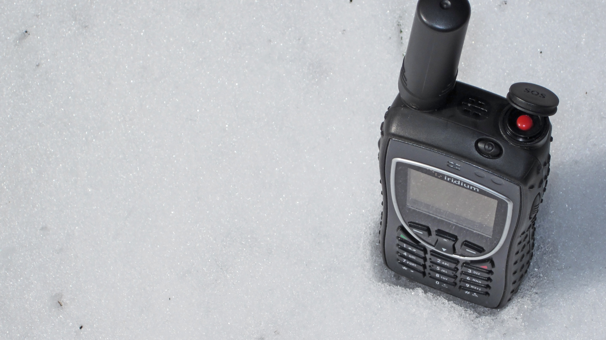 iridium-9575-extreme-satellite-phone-showing-sos-button-in-the-snow-northernaxcess.jpg
