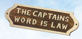 Brass and Wood Nautical Wall Plaque - The Captain's Word Is Law