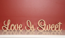 Freestanding MDF wooden words Love Is Sweet. Available in height from 7cm to 11cm