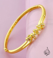 Gold plated bangle with clasp