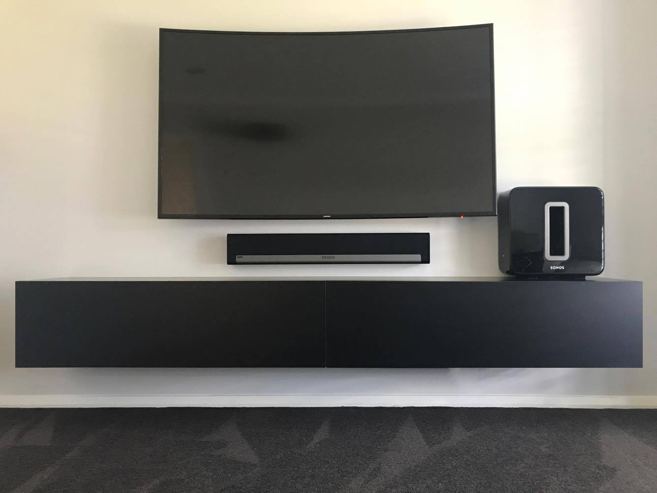 black-floating-tv-entertainement-wall-mounted-unit.jpg